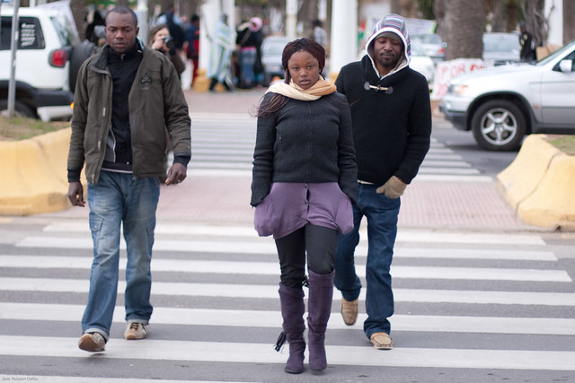 Three Congolese migrants walking
