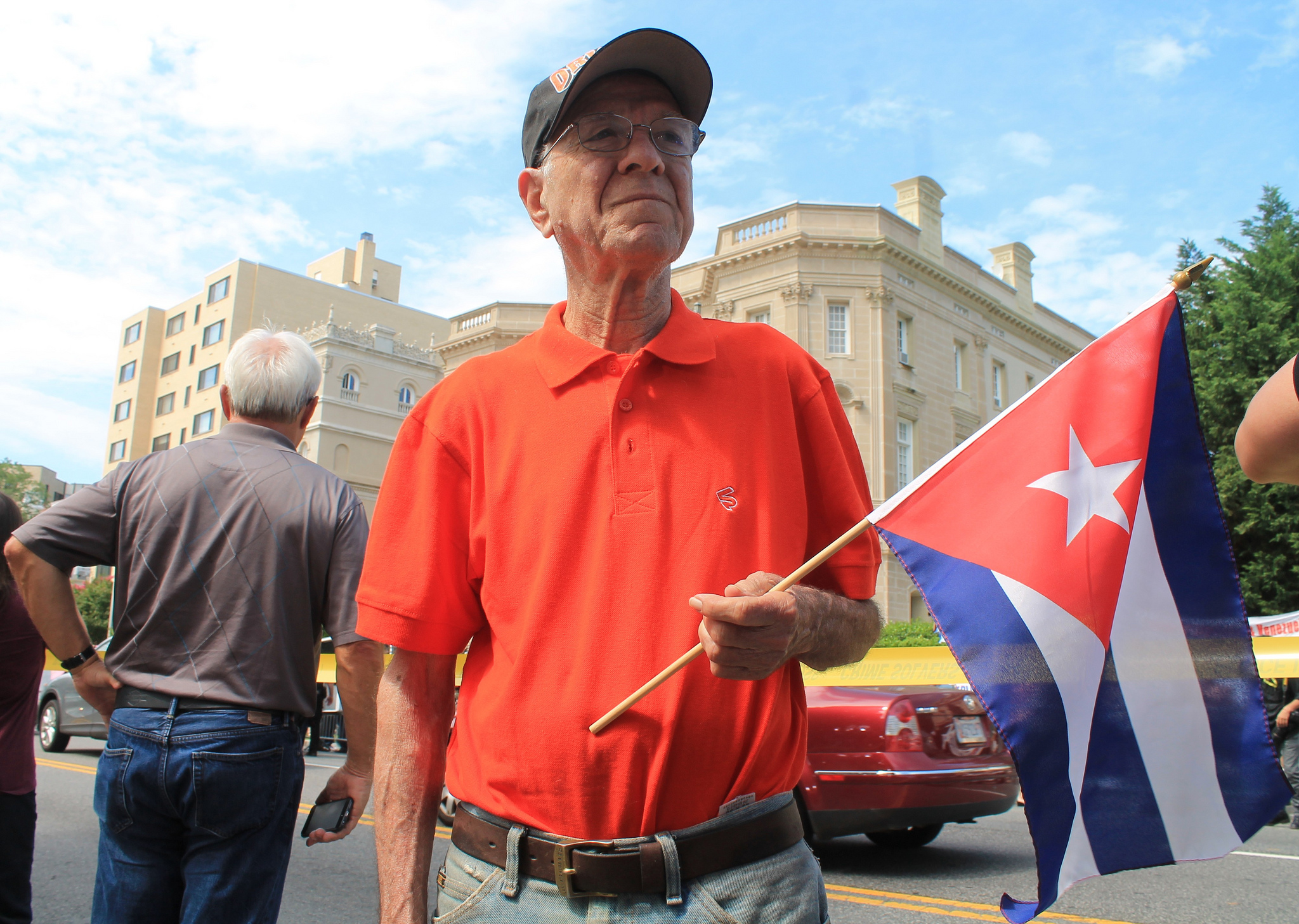 Elderly Cuban man with flag