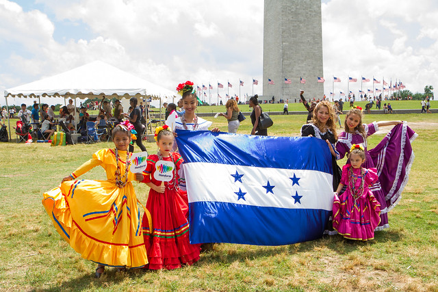 Group of women and girls pose with Honduran flag