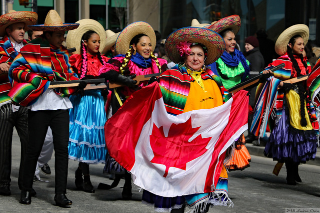 Mexican woman holding a Canadian flag