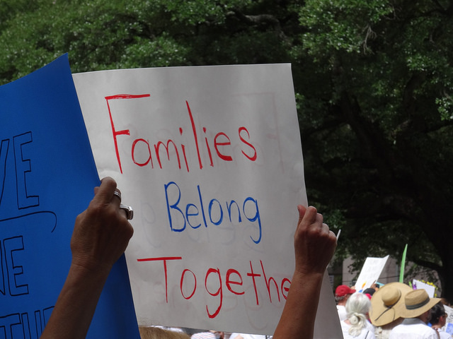 Image of families belong together event banner in Houston