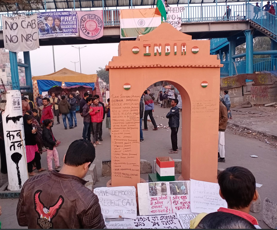 Photo of India gate in Delhi, India featuring names of protestors killed in anti-Citizenship Act demonstrations