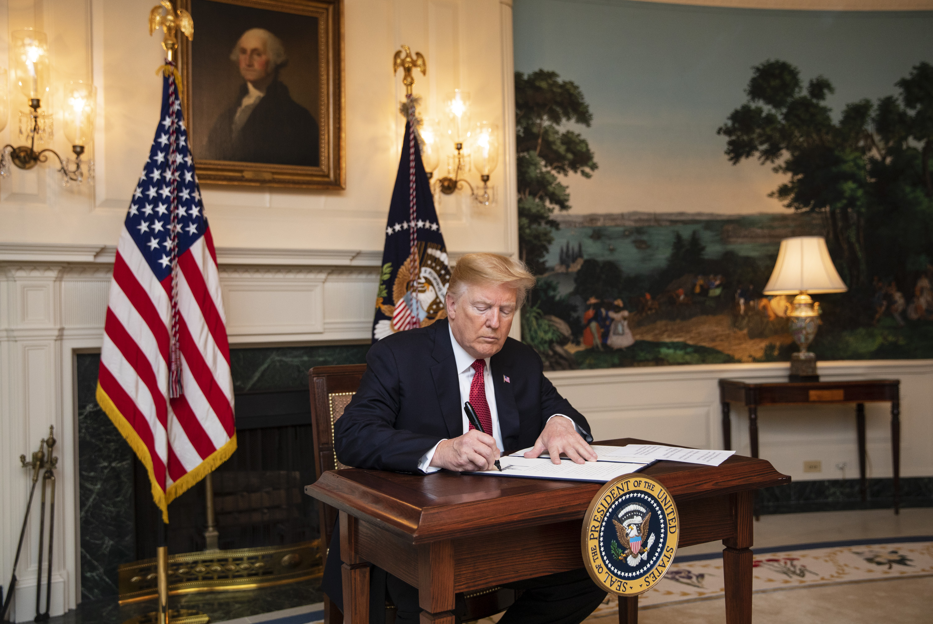 President Trump signs an immigration proclamation at the White House