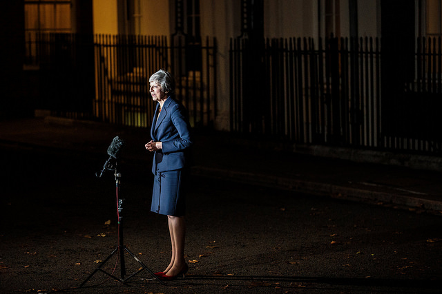 Theresa May speaks to reporters