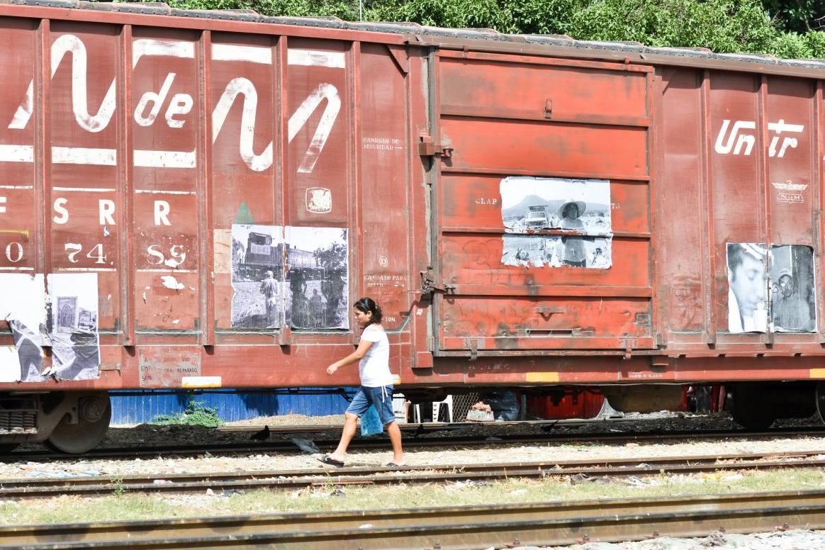 A woman walks alongside a train in Mexico.