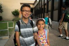 A brother and sister at school