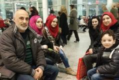 First family of refugees arrives in Toronto.