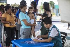 Venezuelans waiting at the Peru border for their documents to be processed