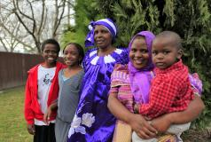 A Burundian refugee family outside their home in Boise, Idaho.