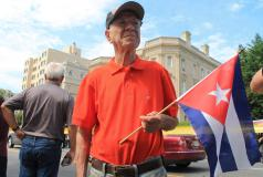 Elderly Cuban man with flag
