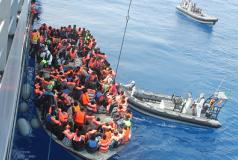 Migrants aboard a rubber vessel are rescued in the Mediterranean