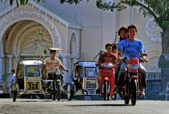 Young people ride motorcycles in Batac, Philippines.
