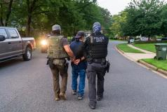 Federal immigration officers make an arrest during an operation in Virginia.