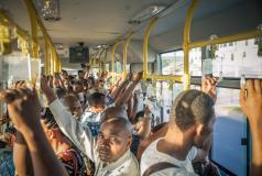 Riders on a bus in Dar es Salaam, Tanzania.