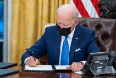 President Joe Biden signs executive orders on immigration in the White House.