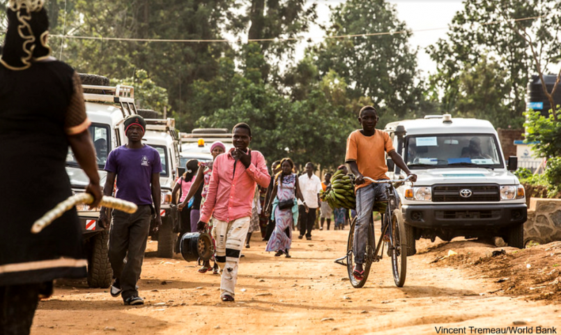 People walking down road in Beni, Africa