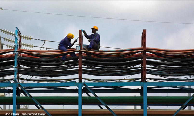 Workers on thermal plant in Ghana