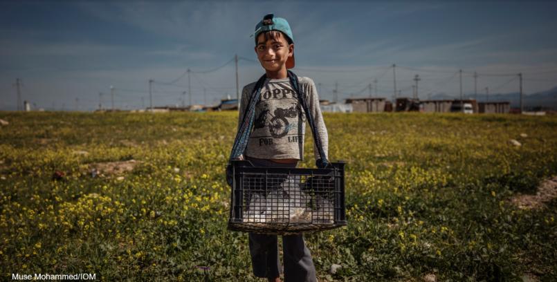 IDP Iraqi boy selling popcorn