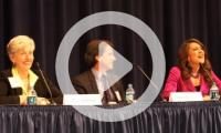 Three panelists in auditorium