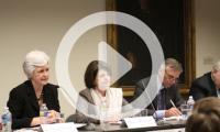 MPI event three panelists behind table