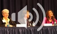 Three panelists in auditorium