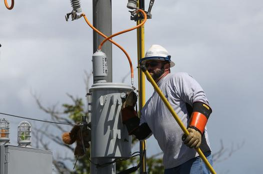 Electrician performs a safety demonstration