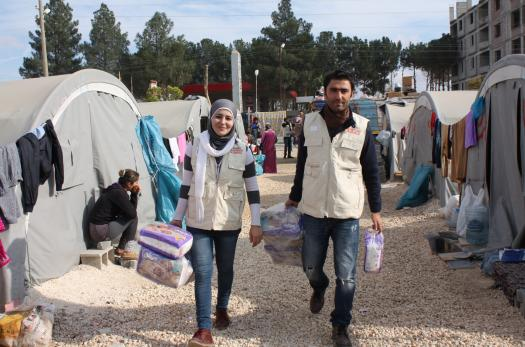 Families at Syrian refugee camp in Suruc, Turkey receive relief supplies