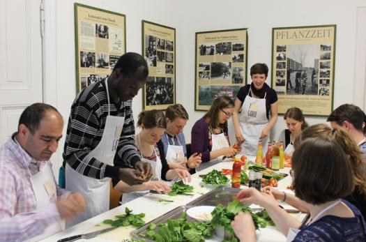 Newcomers and locals participate in an Über den Tellerrand cooking activity in Germany