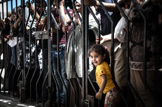Young Iraqi girl at a registration center in Greece