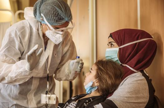 Syrian refugees receive COVID-19 tests from IOM before resettlement to Europe