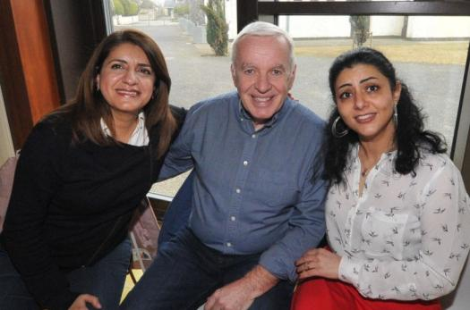 A Syrian refugee sits with her new neighbors in Ireland