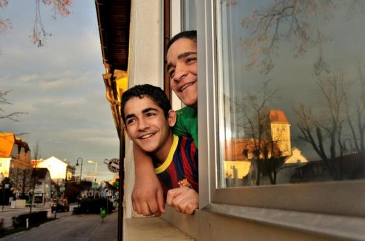 Resettled Syrian refugee brothers at home in Austria