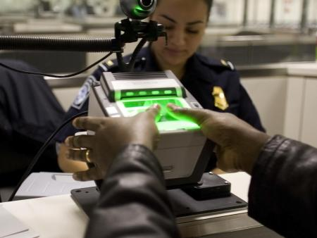 A traveler arriving at Washington Dulles International Airport Monday uses the new US-VISIT mechanism that records all 10 fingerprint images. (Gerald L. Nino/CPB)