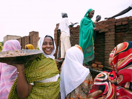 Young women in Darfur learning to construct buildings.