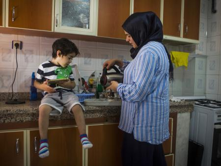 A refugee woman and child at home in Turkey