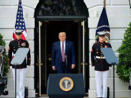 President Trump emerges from the White House to deliver remarks