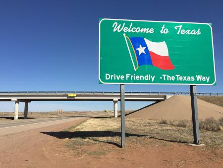 Welcome to Texas sign near highway