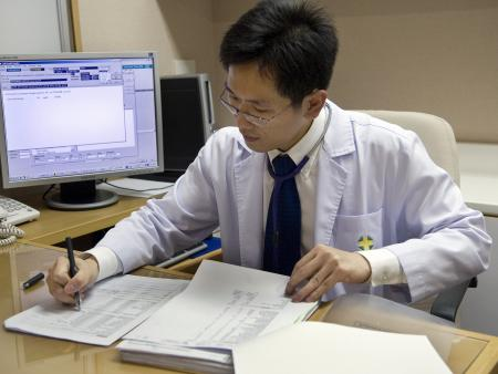 A doctor at his desk at the Bangkok Samitivej hospital.