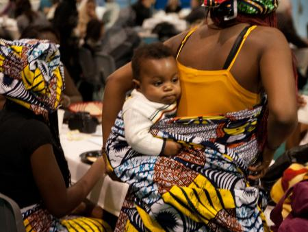 Mother and child at a local refugee art auction & fashion show.
