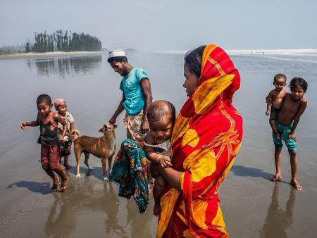 Rohingya family on beach in Teknaf.