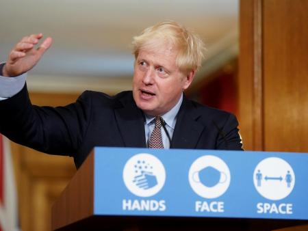 UK Prime Minister Boris Johnson at a press conference about COVID-19