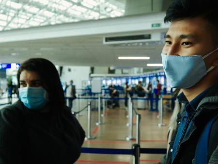 Travelers wearing face masks at the Minsk airport