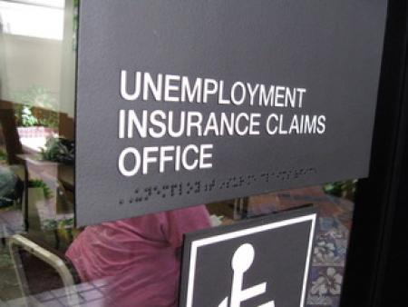 Sign on the window of an unemployment insurance claims office