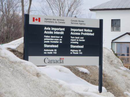 A sign at the Quebec border advises travelers to turn back and report to a port of entry.