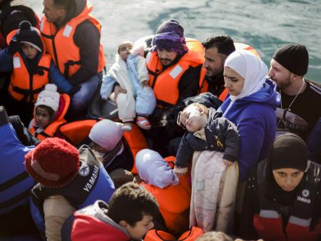 Migrants arrive in Greece on a crowded boat from Turkey.