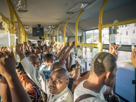 Riders on a bus in Dar es Salaam, Tanzania.