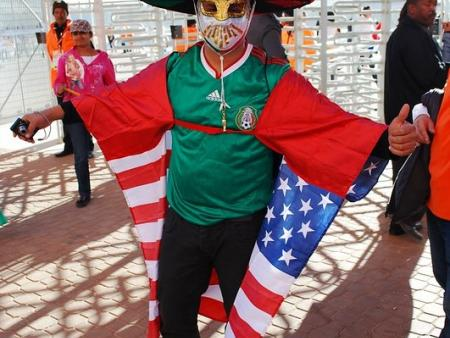 A soccer fan displays a mix of regalia from the United States and Mexico at the 2010 FIFA World Cup.