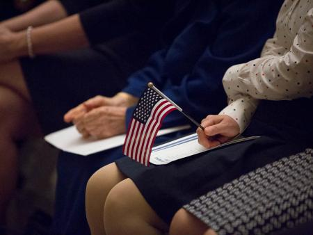 New U.S. citizens attend a naturalization ceremony in Washington, DC.