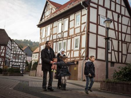 A family from Syria walks through the town of Wächtersbach, Germany, where they now live.