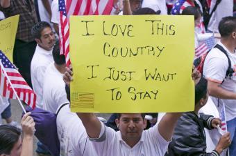 ImmigrantMarchSign SpiritOfAmerica Shutterstock